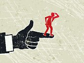 Show Me The Way! A stylized vector cartoon of a giant man's hand  pointing directions to a tiny man, reminiscent of an old screen print poster and suggesting mentor, leadership, direction, on the shoulders of giants, in control, contrasts, attention, or initiate. Hand, Man, paper texture and background are on different layers for easy editing. Please note: clipping paths have been used,  an eps version is included without the path.