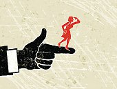 Show Me The Way! A stylized vector cartoon of a giant man's hand  pointing directions to a tiny woman, reminiscent of an old screen print poster and suggesting mentor, leadership, direction, on the shoulders of giants, in control, contrasts, attention, or initiate. Hand, woan, paper texture and background are on different layers for easy editing. Please note: clipping paths have been used,  an eps version is included without the path.