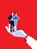 Mentoring!. A stylized vector cartoon reminiscent of an old screen print poster of a giant businesswoman's hand holding a tiny standing businessman and woman. Concept to show relationship issues, recruitment, in hand, control, mentoring or management.