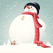 - giant snowman on snowy hill