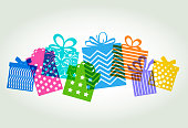 Colourful overlapping silhouettes of patterned gift boxes or presents one Christmas or Birthday