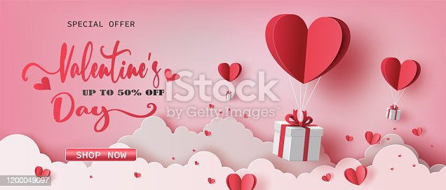istock Gift boxes with heart balloon floating it the sky. 1200049097