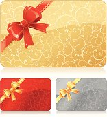 Set of different color gift cards: gold, red, silver