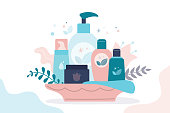 Gift set of organic cosmetics for women. Various bottles, tubes and jars for skincare. Female cosmetics: gels, lotions and creams for body care. Concept of natural products. Flat vector illustration