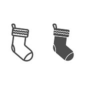 Gift socks line and solid icon. Christmas holiday stocking for presents outline style pictogram on white background. Decorative xmas sock for mobile concept and web design. Vector graphics