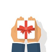 Gift white box with red ribbon and bow in hands of men. Holding in palms gift-box. Vector illustration flat design. Giving, receiving surprise. Isolated on white background.