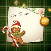 cartoon illustration of gingerbread man and paper with candy, christmas ball and lights on checked pattern background