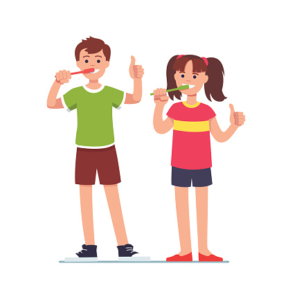 Girl and boy brushing teeth with toothbrushes