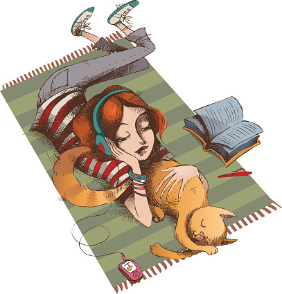Girl and her cat lying on a striped carpet