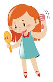 Girl holding mirror and comb