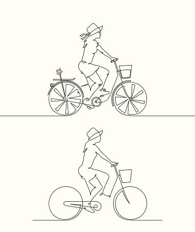 Girl in hat on bike