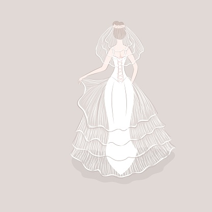 Girl in wedding dress and veil