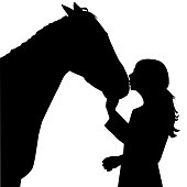 Girl kissing a horse