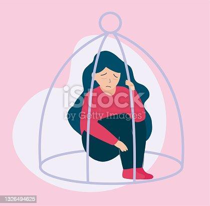 istock Girl locked inside a cage like a bird 1326494625