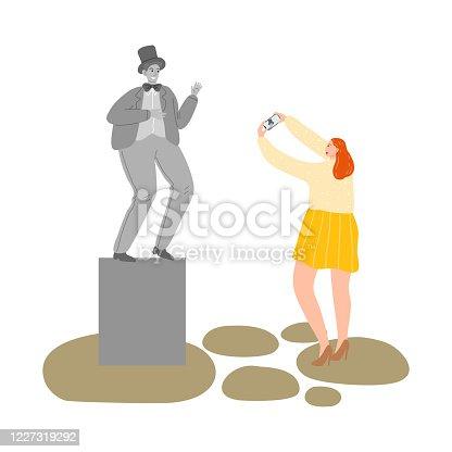 istock Girl making photo of man mime street atrist showing statue 1227319292