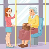 Girl offering seat to old lady in public transport
