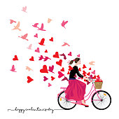 Beautiful girl wearing bandana pony tail black blouse long red skirt ballerinas rides a retro-style pink bicycle with basket full of hearts spreads good mood love joy freedom magenta hearts and birds flying like a fresh breeze around her. Original artwork illustration square shape on white background with typography.