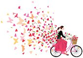Beautiful girl wearing bandana pony tail black blouse long red skirt ballerinas rides a retro-style pink bicycle with basket full of red poppy flowers spreads good mood love joy freedom colorful hearts flowers butterflies and birds flying like a fresh breeze. Original artwork illustration rectangular shape on white background.