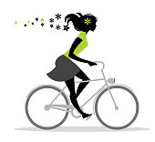 Girl silhouette on bike with flowers