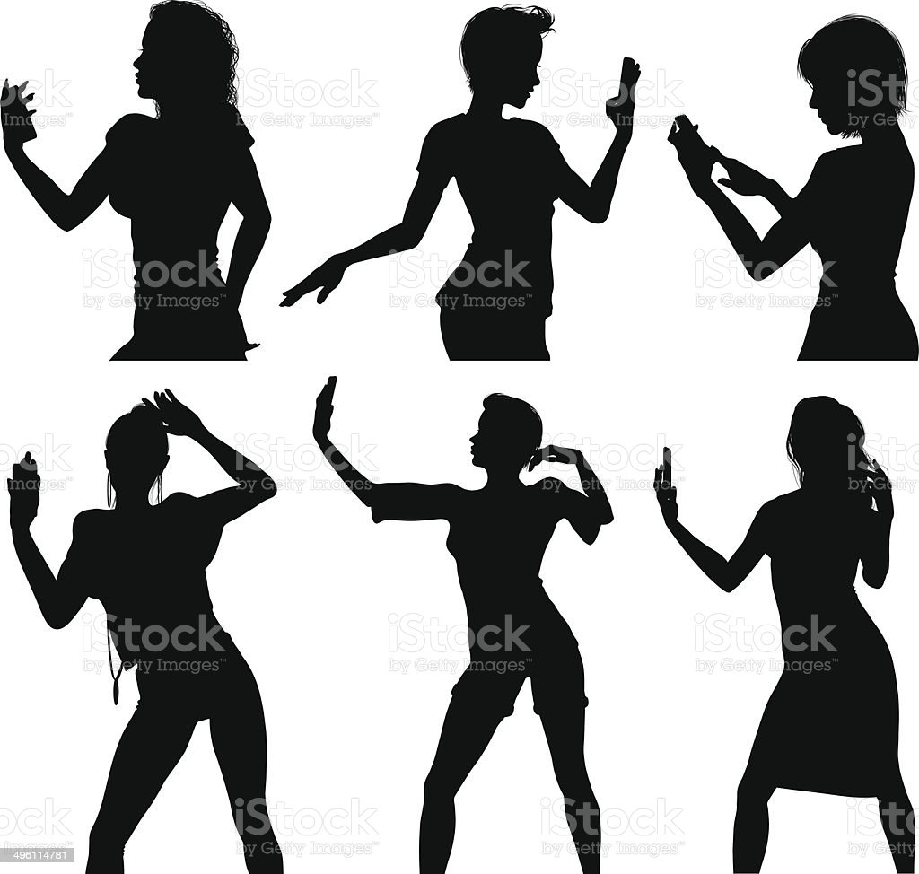Girl silhouettes taking selfie with smart phone vector art illustration