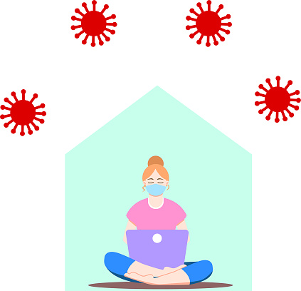 Girl sitting with laptop in lotus position. Young woman working on the notebook, studying, browsing internet, chatting, blogging. Social distancing during pandemic of coronavirus (COVID-19). Stay home