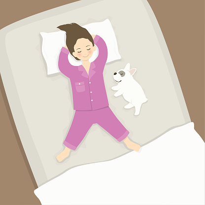 Girl sleeping with dog in bed