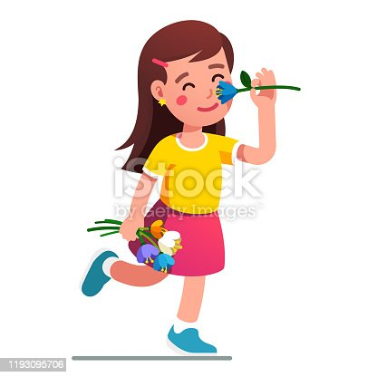istock Girl smelling flower. Kid holding tulip bouquet 1193095706