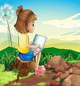 istock girl surfing the net while sitting above a stump 472362473