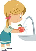 Girl washing fruit