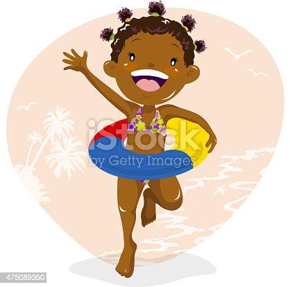 Little girl wearing inner tube at beach