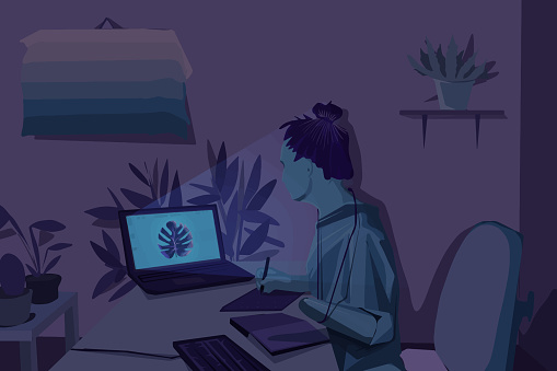 Girl with deformation working on a drawing at night