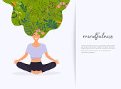 Girl with flower hair in gyan mudra yoga lotus pose exercise. Meditation health benefits for body, mind and emotions.