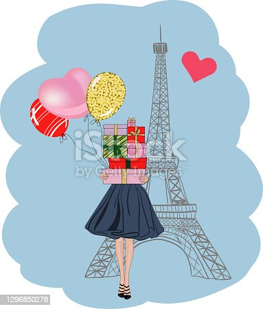 istock Girl with gifts and balloons at the Eiffel Tower. 1296850278