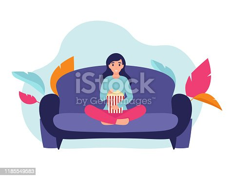 istock girl with popcorn on the couch 1185549583