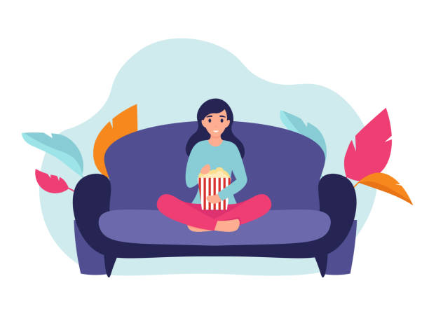 girl with popcorn on the couch Woman at home sitting on sofa, watching movie and eating popcorn. Flat vector cartoon illustration home comfort concept. watching tv stock illustrations