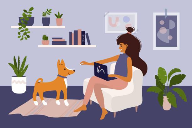 Girl working on laptop at home and playing with dog – artystyczna grafika wektorowa