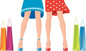 Two girlfriends are shopping in short skirts and high heels.