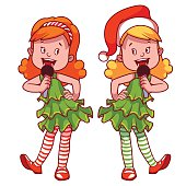 Girls in Christmas dress singing with microphone.