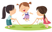 istock Girls playing jump rope 944799832