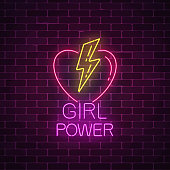 Girls power sign in neon style on dark brick wall background. Glowing symbol of female slogan with heart and lightning shapes. Women rights. Vector illustration.