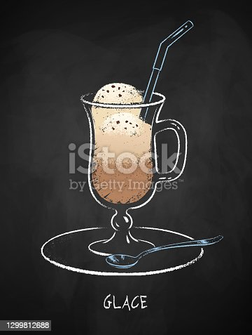 istock Glace coffee cup isolated on black chalkboard 1299812688