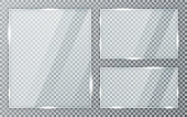 Glass plates set on transparent background. Acrylic and glass texture with glares and light. Realistic transparent glass window in rectangle frame. Vector