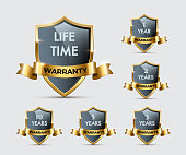 Glass shields with golden frames and ribbons with different warranty texts. Vector warranty shields isolated on transparent background