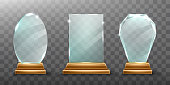 Glass trophy or winner award realistic vector illustration. Transparent crystal plate or blue acrylic frame different shapes on wooden pedestal, isolared front view with light and shadow