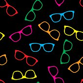 Vector illustration of multi colored glasses on a black background in a repeating pattern.