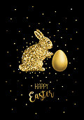 An original artwork vector illustration of a glitter gold rabbit with happy Easter message over black background. This inspirational design can be a postcard, invitation or flyer.