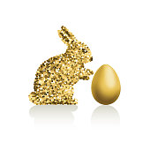 An original artwork vector illustration of a glitter gold rabbit with gold Easter egg. This inspirational design can be a postcard, invitation or flyer.