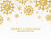 Glitter gold snowflakes and falling particles on white background. Merry Christmas and Happy New Year banner. Luxury festive greeting card. Sparkling golden snowflakes. Vector Illustration.