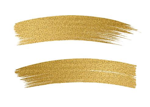 Glitter golden brush stroke on white background