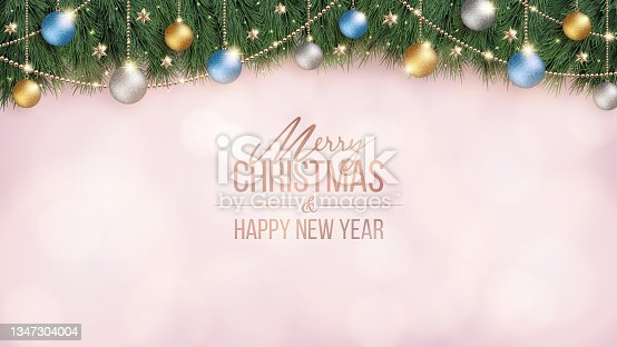 istock Glittering Christmas decorations and pink blurred background. 1347304004